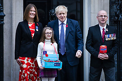 © Licensed to London News Pictures. 28/10/2019. London, UK. Prime Minister Boris Johnson outside 10 Downing Street as he buys a poppy for the Royal British Legion Poppy Appeal. The EU has agreed to extend the Brexit deadline. Later today MPs will vote on whether to hold a general election in early December. Photo credit: Rob Pinney/LNP
