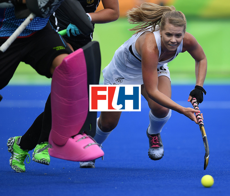 New Zealand's Kirsten Pearce tries to get past Germany defences during the women's field hockey New Zealand vs Germany match of the Rio 2016 Olympics Games at the Olympic Hockey Centre in Rio de Janeiro on August, 8 2016. / AFP / MANAN VATSYAYANA        (Photo credit should read MANAN VATSYAYANA/AFP/Getty Images)