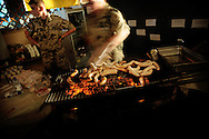 A german barbecue at the military airport in Kabul during a party for the ISAF forces in Afghanistan.<br /> For more caption info, please contact photographer.