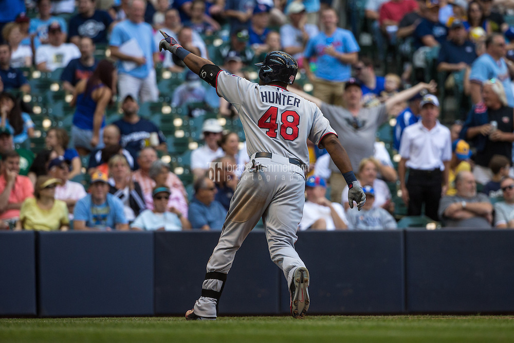 MILWAUKEE, WI- JUNE 27: Torii Hunter #48 of the Minnesota Twins celebrates after hitting a home run against the Milwaukee Brewers on June 27, 2015 at Miller Park in Milwaukee, Wisconsin. The Twins defeated the Brewers 5-2. (Photo by Brace Hemmelgarn) *** Local Caption *** Torii Hunter