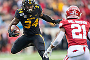 LITTLE ROCK, AR - NOVEMBER 29:  Larry Rountree III #34 of the Missouri Tigers runs the ball during a game against the Arkansas Razorbacks at War Memorial Stadium on November 29, 2019 in Little Rock, Arkansas  The Tigers defeated the Razorbacks 24-14.  (Photo by Wesley Hitt/Getty Images) *** Local Caption *** Larry Rountree III