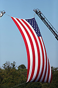 A large American flag flies outside the stadium before the Washington Redskins 2016 NFL week 1 regular season football game against the Pittsburgh Steelers on Monday, Sept. 12, 2016 in Landover, Md. The Steelers won the game 38-16. (©Paul Anthony Spinelli)