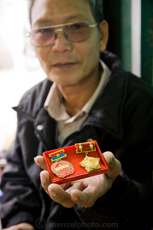 Vietnamese war veteran Nguyen Van Thuan displays his medals in Hanoi, Vietnam. (Nguyen Van Thuan is featured in the book What I Eat: Around the World in 80 Diets.) MODEL RELEASED.