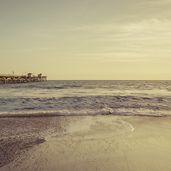 San Clemente pier at sunset retro panorama photo. San Clemente is a popular coastal beach city along the Pacific Ocean in Orange County Southern California in the States of America. Panoramic photo ratio is 1:3. Copyright ⓒ 2017 Paul Velgos with all rights reserved.