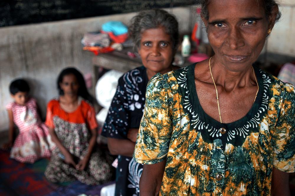 Women whose homes were destroyed by the December 26, 2004 Tsunami that struck S.E. Asia following a 9.0 earthquake in the Indian Ocean now live at the Koddaimunai Junior School along with more than 600 other displaced families..Batticaloa, Sri Lanka. 11/01/2005.Photo © J.B. Russell