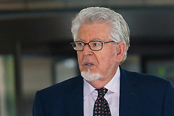 London, May 22nd 2014. Entertainer Rolf Harris leaves Southwark Crown Court after testimony from the final prosecution witnesses in his trial on 12 counts of indecent assault against four girls aged between 7 and 19.