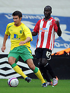 Lincoln - Wednesday, July 28th, 2010: Lincoln's Albert Jarrett and Norwichs's George Francomb pictured during the Pre Season friendly match at Sincil Bank. (Pic by Andrew Stunell/Focus Images)