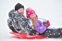 © Licensed to London News Pictures.27/02/2018<br /> IGHTHAM, UK.<br /> <br /> Joshua Daley ( age 7)  Morgan Daley (age 6) Sledging  in the snow at Ightham Park, Kent.<br /> Snow fun and games for children having the day off from school because of the snowy weather.<br /> Photo credit: Grant Falvey/LNP