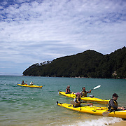 People kayaking on crystal clear waters of Abel Tasman National Park, South Island, New Zealand, 5th February 2011. Photo Tim Clayton.