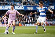 Reading striker Yann Kermorgant (29) looks to chip the ball over the QPR keeper during the Sky Bet Championship match between Queens Park Rangers and Reading at the Loftus Road Stadium, London, England on 23 April 2016. Photo by Andy Walter.