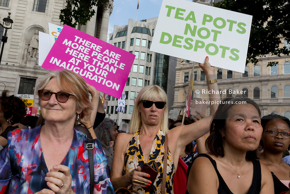 Protesters against the visit of US President Donald Trump to the UK, gather in Trafalgar Square after marching through central London, on 13th July 2018, in London, England.