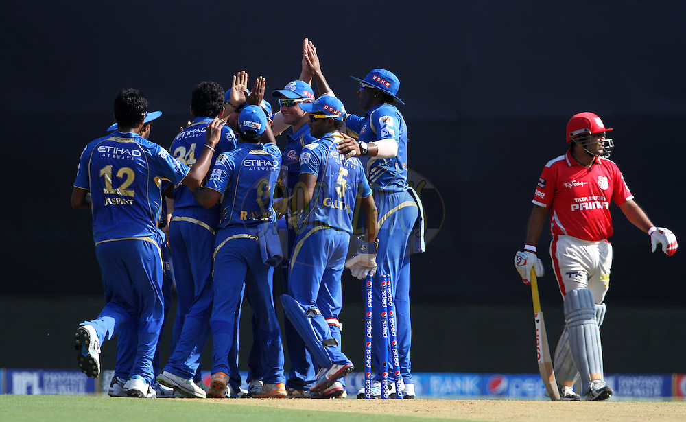 Mumbai Indians players celebrates after getting the wicket of Virender Sehwag of the Kings X1 Punjab during match 22 of the Pepsi Indian Premier League Season 2014 between the Mumbai Indians and the Kings XI Punjab held at the Wankhede Cricket Stadium, Mumbai, India on the 3rd May  2014<br /> <br /> Photo by Vipin Pawar / IPL / SPORTZPICS<br /> <br /> <br /> <br /> Image use subject to terms and conditions which can be found here:  http://sportzpics.photoshelter.com/gallery/Pepsi-IPL-Image-terms-and-conditions/G00004VW1IVJ.gB0/C0000TScjhBM6ikg