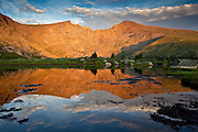 Mount Bierstadt 14,060ft reflected in an alpine tarn at sunset.