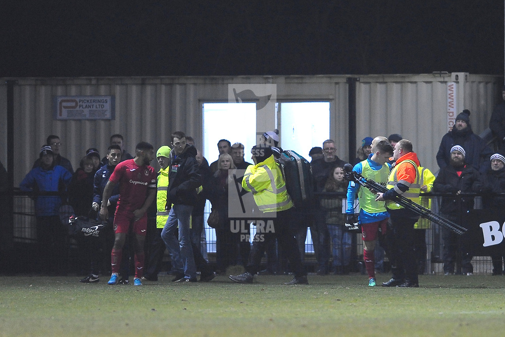 TELFORD COPYRIGHT MIKE SHERIDAN The game is paused for five minutes while a pitch-side cameraman receives treatment for a fall during the Vanarama Conference North fixture between Darlington and AFC Telford United at Blackwell Meadows on Saturday, November 30, 2019.<br /> <br /> Picture credit: Mike Sheridan/Ultrapress<br /> <br /> MS201920-032