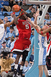 28 December 2006: Rutgers center (5) Hamady N'Diaye defended by guard (2) Wayne Ellington and forward (50) Tyler Hansbrough during a 87-48 Rutgers Scarlet Knights loss to the North Carolina Tarheels, in the Dean Smith Center in Chapel Hill, NC.<br />
