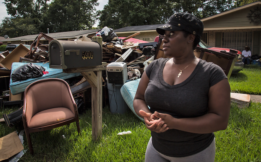 Aug 19, Roxanna Johnson in front of her flooded home in East Fariline, a subdivision in Baton Rouge, surveying her block. She was rescued by boat. She said boats from differnt parishes appeared to rescue her and her neighborhoods and she is greatful for that.
