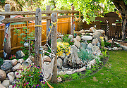 "The secluded back yard is an ongoing labour of love. Joe Laturnus, better known as ""Joe the Rockman"", designed the yard and continues to develop it with Bev's help. Heritage Buena Vista home of Bev and Julian Beaudry. Interior and exterior shoot for Saskatoon Home Magazine, Fall 2010 issue, SH8 (Spotlight) article."