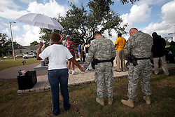 29 August 2007. Lower 9th Ward, New Orleans, Louisiana. <br /> Second anniversary of Hurricane Katrina. Residents gather at the hurricane Katrina memorial in the Lower 9th Ward to remember those who perished when the industrial canal levee breached less than a mile from where they stand. Many residents are struggling to return to the still derelict and decimated Lower 9th Ward.<br /> Photo credit; Charlie Varley/varleypix.com