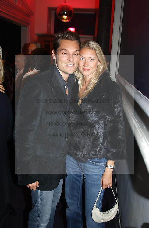 MR &amp; MRS SEB BISHOP she was model Heidi Wichlinski former girlfriend of racing driver David Coulthard at a party hosted by jeweller Theo Fennell and Dominique Heriard Dubreuil of Remy Martin fine Champagne Cognac entitles 'Hot Ice' held at 35 Belgrave Square, London, W1 on 26th October 2004.<br />