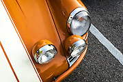 Image of an orange Porsche 911 T/ST at Rennsport Reunion V at Laguna Seca in Monterey, California, America west coast