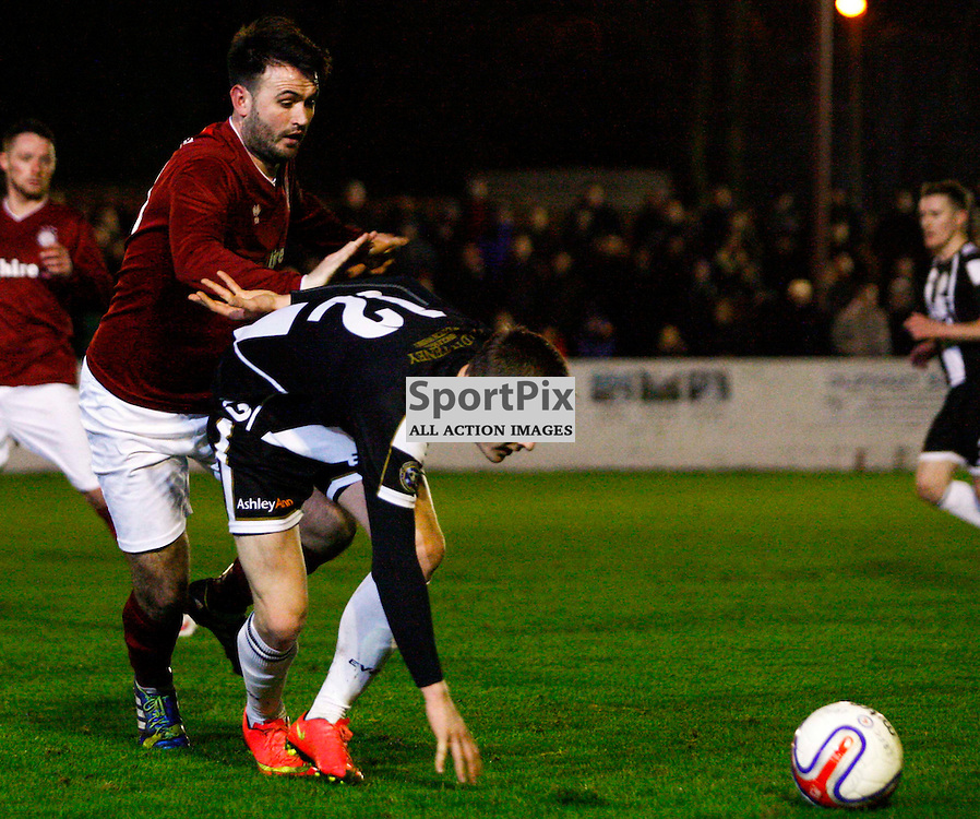 Wicks Steven Harrison tries to hold off Linlithgow striker Tommy Coyne during tonights Scottish Cup tie at Linlithgow