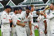Alastair Cook of Essex turns to give a thumbs during the trophy celebrations up as Essex celebrate winning the County Championship during the Specsavers County Champ Div 1 match between Somerset County Cricket Club and Essex County Cricket Club at the Cooper Associates County Ground, Taunton, United Kingdom on 26 September 2019.