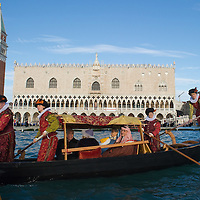 VENICE, ITALY - DECEMBER 26: Gondoliers dressed in XVI century costumes perform a live nativity scene, whilst ferrying passengers in gondolas from St Mark's to the Island of S Giorgio on December 26, 2011 in Venice, Italy.  The event is in its first year wants and to replicate an ancient tradition when the Doge of Venice used to go to the Island of S Giorgio to celebrate the relics of Santo Stefano on Boxing Day. HOW TO LICENCE THIS PICTURE: please contact us via e-mail at sales@xianpix.com or call our office London   +44 (0)207 1939846 for prices and terms of copyright. First Use Only ,Editorial Use Only, All repros payable, No Archiving.© MARCO SECCHI