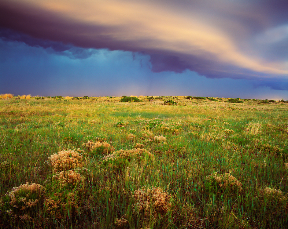 0262-1000B ~ Copyright:  George H.H. Huey ~ Fast moving spring thunderstorm at dusk.  Llano Estacado.  Kiowa National Grasslands, New Mexico...Fast moving spring thunderstorm at dusk.  Llano Estacado.  Kiowa National Grasslands, New Mexico.