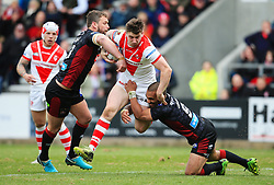 St Helens' Mark Percival takes on Wigan Warriors' Thomas Leuluai during the Super League match at the Totally Wicked Stadium, St Helens.