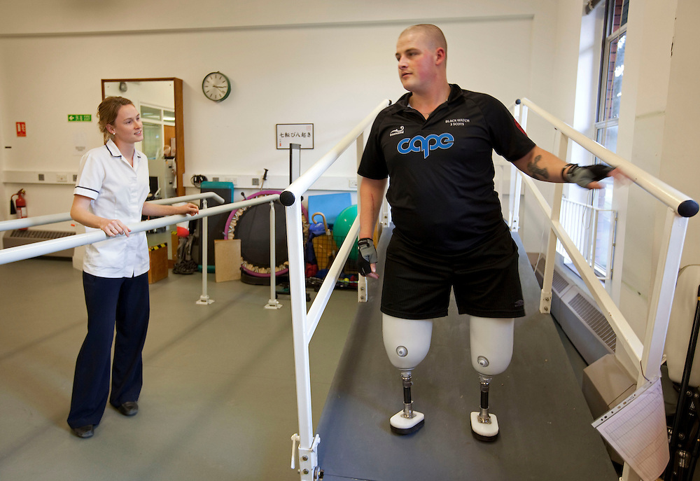 Pte Stephen Bainbridge of the Black Watch (3 SCOTS) who lost both legs in an IED explosion on the 11th of November 2011 in Loya Manda, Helmand Province,  Afghanistan is now recovering well in Headley Court RAF Hospital. His physiothreapist, Claire Painter (left) descibes him as a very determind man. He is making rapid progress on his mission to walk again. Headley Court, England on the 20th of March 2012.