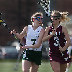 Nerinx Hall's Perry Lodes (7) looked for a pass opportunity around Villa Duchesne's Kelsey Adamitis (3) in the first half of a game between Nerinx Hall High School and Villa Duchesne at Nerinx Hall in Webster Groves April 5, 2016. Villa Duchesne won 9-8. Teak Phillips | St. Louis Review