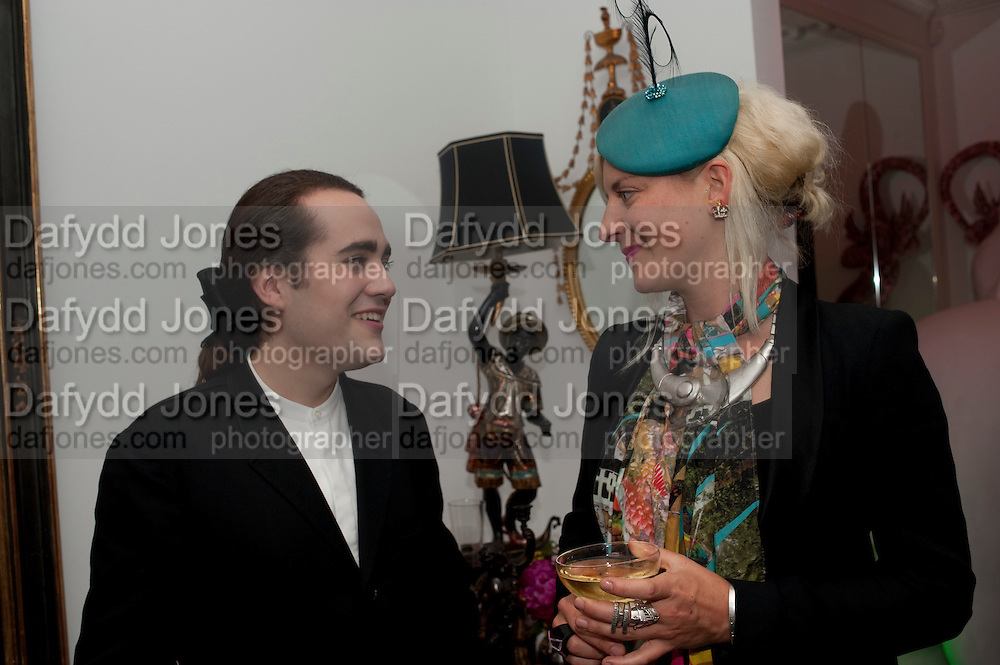 CHARLES ELIASCH; VICTORIA GRANT, Party at the home of Amanda Eliasch in Chelsea after the opening of As I Like it. A memory by Amanda Eliasch and Lyall Watson. Chelsea Theatre. Worl's End. London. 4 July 2010<br /> <br />  , -DO NOT ARCHIVE-© Copyright Photograph by Dafydd Jones. 248 Clapham Rd. London SW9 0PZ. Tel 0207 820 0771. www.dafjones.com.
