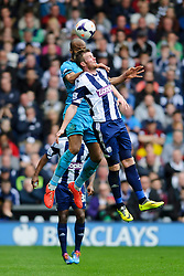 Younes Kaboul (FRA) of Tottenham Hotspur and Chris Brunt (NIR) of West Brom compete in the air - Photo mandatory by-line: Rogan Thomson/JMP - 07966 386802 - 12/04/2014 - SPORT - FOOTBALL - The Hawthorns Stadium - West Bromwich Albion v Tottenham Hotspur - Barclays Premier League.
