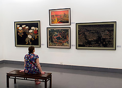 Woman looking at paintings at Vietnam Museum of Fine Arts in Hanoi