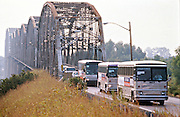 "US President Bill Clinton ""Bridge to the 21st Century"" campaign bus crosses the Mississippi River on their way to a campaign stop August 30, 1996 in Cairo, IL."