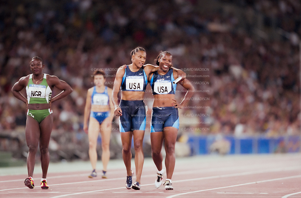 SYDNEY -  SEPTEMBER 30:  Marion Jones (left) and Monique Hennigan (right) of the USA walk on the track following the Women's 4x400 meter event of the 2000 Summer Olympics track and field competition held on September 30, 2000 at the Olympic Stadium in Sydney, Australia. (Photo by David Madison/Getty Images) *** Local Caption *** Marion Jones;Monique Hennigan