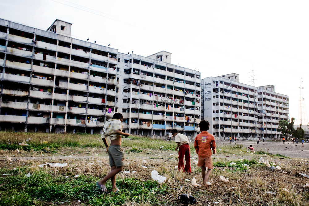 """""""slum rehabilitation"""" project forced people to move to places like the Lallubhai Compound in Mankurd, where buildings cluster ominously, each separated from the other by a small corridor full of garbage. More than 60,000 people live in this new kind of slum after their homes were demolished 22 November 2009."""