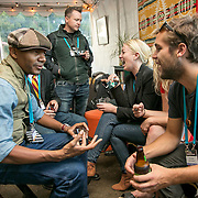 DJ Spooky, left talks with Peter Hans Ward, of AREDAY, at the Summit Tent during the Bioneers Conference 2015; San Rafael, CA