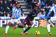 Ainsley Maitland-Niles of Arsenal (15) gets past Jason Puncheon of Huddersfield Town (42) during the Premier League match between Huddersfield Town and Arsenal at the John Smiths Stadium, Huddersfield, England on 9 February 2019.