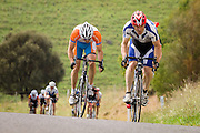 """Veteran cyclists riding uphill to finish of """"Red Rock Classic"""" race"""