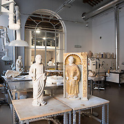 Rome, Italy, March 29, 2017. Istituto Superiore per la Conservazione ed il Restauro.  Workshop of stone materials and decorated architectural surfaces. Sculptures from the Museo Diocesano di Arte Sacra of Orte,  from the tabernacle of the Cathedral: on the left, San Pietro and on the right, San Lorenzo.<br />