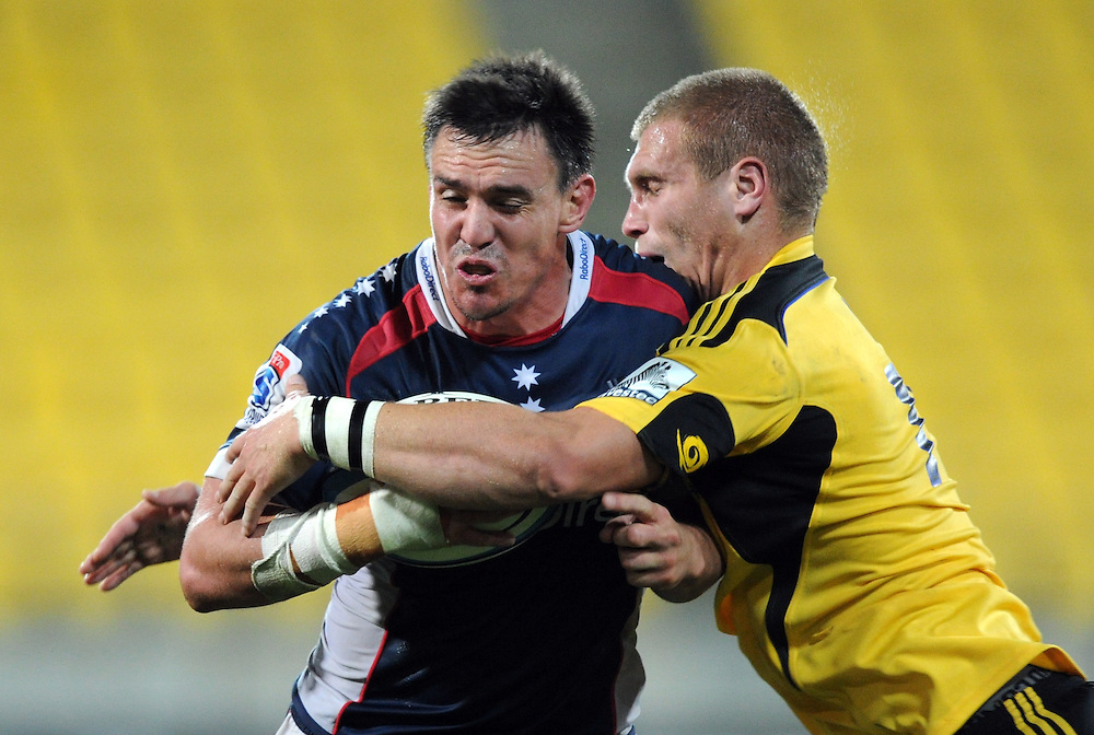 Rebels Nic Henderson, left, is tackled by Hurricanes Brad Shields in the Super 15 Rugby match, Westpac Stadium, Wellington, New Zealand, Saturday, May 26, 2012. Credit:SNPA / Ross Setford