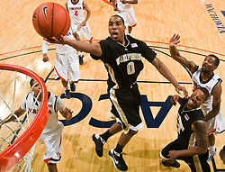 Wake Forest guard Jeff Teague (0) shoots a layup against UVA.  The Virginia Cavaliers fell to the #13 ranked Wake Forest Demon Deacons 70-60 at the John Paul Jones Arena on the Grounds of the University of Virginia in Charlottesville, VA on February 28, 2009.