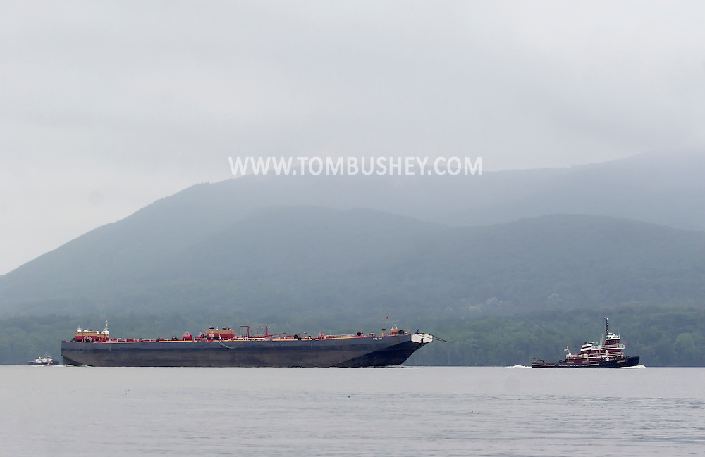 New Windsor, New York - A tugboat pulls the tanker barge RTC 120 down the Hudson River on June 13, 2010.