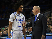 Nov 6, 2019; Los Angeles, CA, USA; UCLA Bruins head coach Mick Cronin (right) talks with guard Tyger Campbell (10) in the first half against the Long Beach State 49ersat Pauley Pavilion.