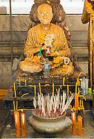 Incense burning Buddha Wat Intharawihan Bangkok Thailand&#xA;<br />