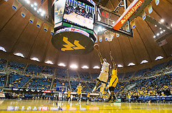 Dec 5, 2015; Morgantown, WV, USA; West Virginia Mountaineers guard Daxter Miles Jr. (4) drives down the lane and shoots during the second half against the Kennesaw State Owls at WVU Coliseum. Mandatory Credit: Ben Queen-USA TODAY Sports