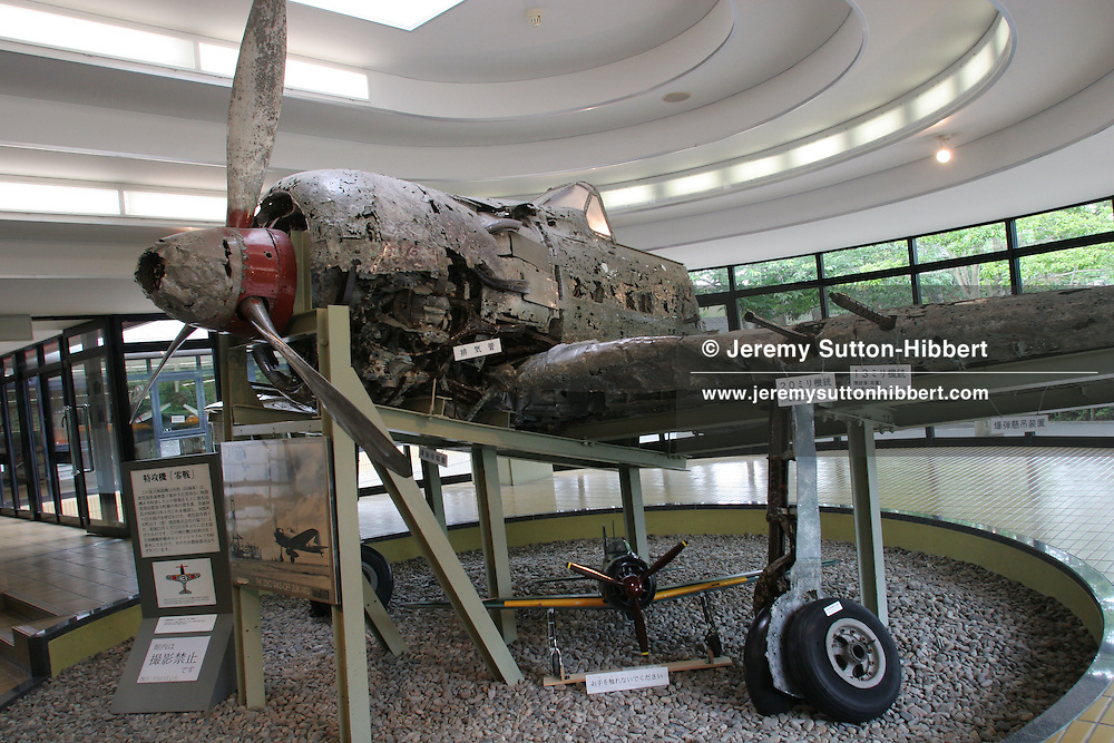 WRECKAGE OF KAMIKAZE 'ZERO FIGHTER' PLANE. The Zero Fighter' landed in water after developing engine trouble in May 1943. The plane was rescued from the sea bed in 1980 and now is on display at the Special Attack Peace Memorial Museum, in Chiran, Kyushu Island, Southern Japan. Chiran was the airbase from where kamikaze pilots took off on their final missions.