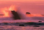 Image of crashing wave over the Pacific Ocean at sunset in Westport, California