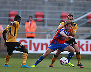 Dagenham player Christian Doidge shields the ball from Newport County defender Danny Holmes and Newport County midfielder Nathan Ofori-Twumasi during the Sky Bet League 2 match between Dagenham and Redbridge and Newport County at the London Borough of Barking and Dagenham Stadium, London, England on 19 September 2015. Photo by Bennett Dean.